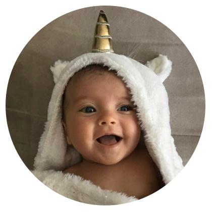 baby with unicorn horn blanket